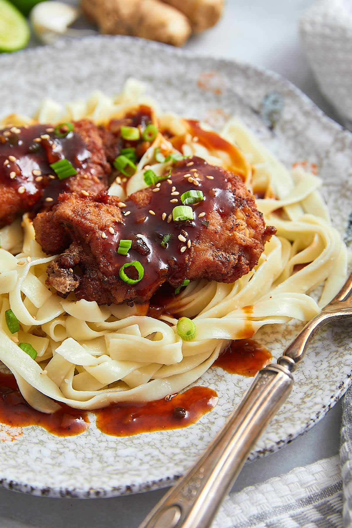 Boneless Skinless Chicken Thighs with Lime-Sesame BBQ Sauce - crispy fried chicken thighs served with a delicious BBQ sauce and a bowl of pasta. | ifoodblogger.com
