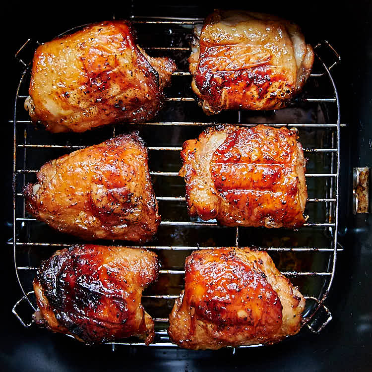These air fryer chicken thighs are so good that you'll be making them again and again. Quickly marinated in a delicious Asian inspired sauce, they are slightly sweet from maple syrup with a hint of tartness from lime juice. They taste amazingly good! I guarantee you, these are some of the best chicken thighs you can make. They are a must try! Oh, and they only take about 30 minutes to make.| ifoodblogger.com