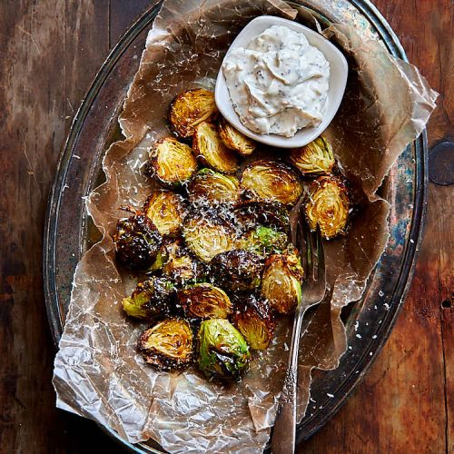 Crispy air fried Brussels sprouts, seasoned with olive oil, Parmesan cheese, salt and pepper, and fried to perfection in an air fryer. These Brussels sprouts are truly crispy and have a crunch as you bite into them. Serve these fried Brussels sprouts with a delicious bagel sesame dipping sauce. | ifoodblogger.com