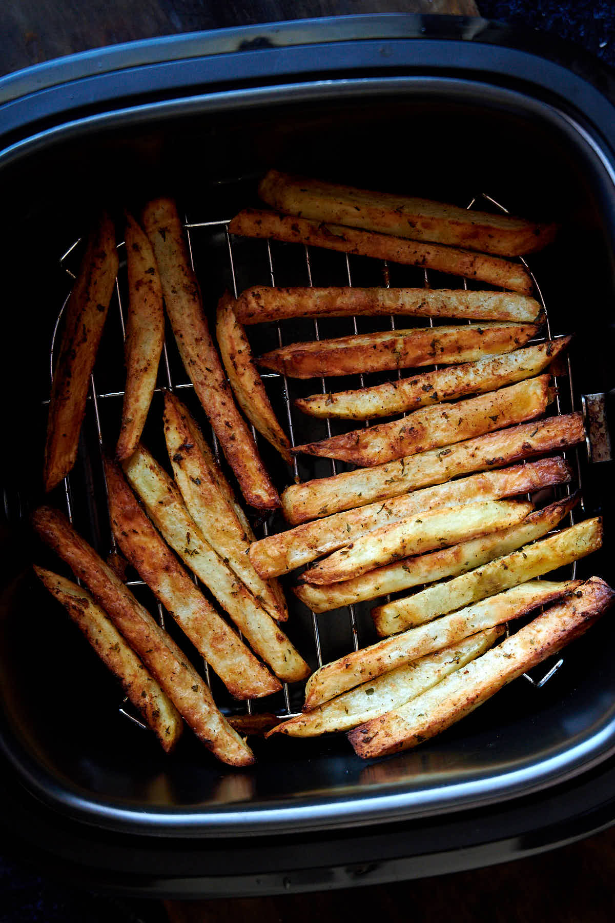 These air fryer French fries are extra crispy and crunchy on the outside and creamy on the inside. They are like deep-fried fries, only without a mess and added calories. They taste amazingly good! I guarantee you, these are some of the best French fries you can make at home. These French fries are a must try! | ifoodblogger.com
