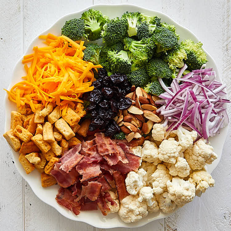 Broccoli and cauliflower ingredients, separated and arranged on a big platter.